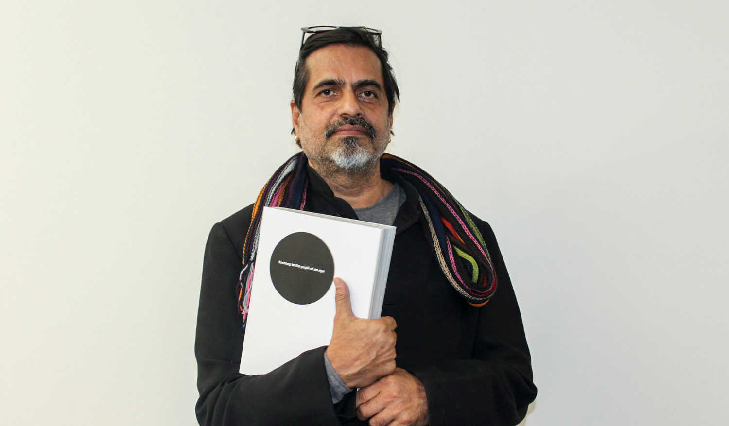 Sudarshan Shetty, Curator, Kochi-Muziris Biennale 2016, with review catalogue of the Third Edition